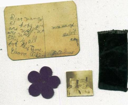 Post card from Eleanor written to Nancy in Beloit, Kansas, a note showing F. W. SHAMBURG, Scottville, Kansas and a newspaper clipping of a casualty list containing Captain Charles W. AIKINS name, who was wounded in action.